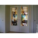 Moderne toepassing van glas-in-lood in een schuifdeur